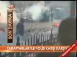 Taraftarlar ile polis karşı karşıya  online video izle