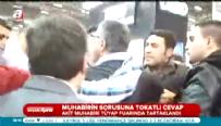 Ekrem Dumanlı'nın koruması Akit muhabirini tokatladı