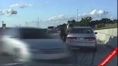 Kadın sürücünün otomobili polisi teğet geçti