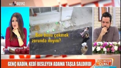 Genç kadın, kedi besleyen adama taşla saldırdı