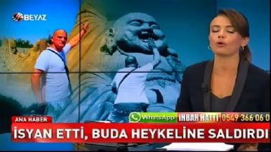 Buda heykeline saldırdı