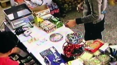 Markette tırnakçıklıkla hırsızlık kamerada