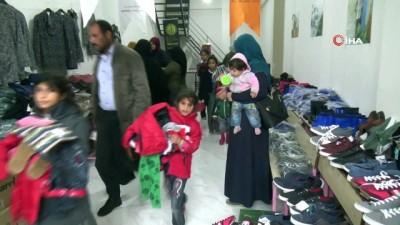 hayirseverler -  Siverek'te 400 yetim ve öksüz çocuğa giyim yardımı yapıldı