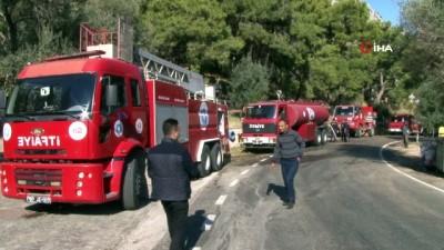 Antalya'da 600 metrelik sarp arazide çıkan yangında hortum taşıma seferberliği