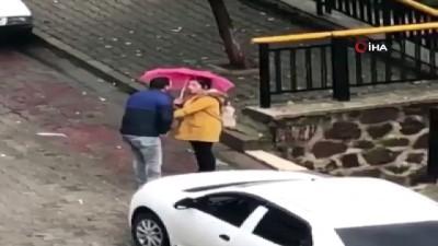 Genç kadına sokak ortasında tekme tokat dayak kamerada