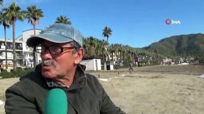 - Marmaris'te denizin çekilmesi deprem endişesine neden oldu