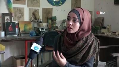 - Filistinli Kadın Sanatçı Baharatla Resim Yapıyor