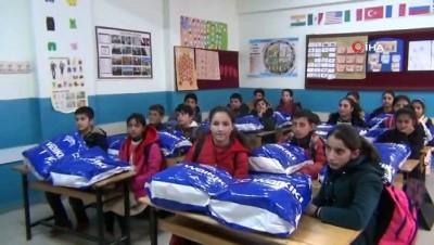 ogretmen -  Metin Külünk Dostluk Grubu'ndan Ercişli 550 öğrenciye kışlık kıyafet yardımı