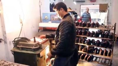 Bu iş yerinde gazi ve şehit yakınlarına ayakkabı bedava - HATAY