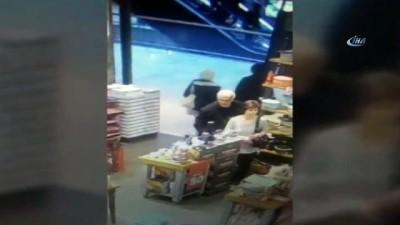 Kadın hırsızlar kaşla göz arasında çantayı çalıp kayıplara karıştı... Olay saniye saniye böyle görüntülendi