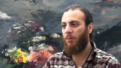 Suriye'deki iç savaşı belgeselle anlatıyor - Yönetmen Al Hakawati