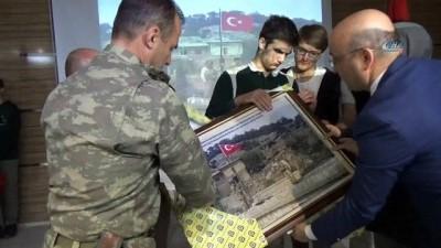 Amasya'dan gönderilen bayrak Afrin'de dalgalanıyor