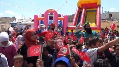 - Suriye'de savaşın çocukları gönüllerince eğlendi -  Suriye'de 23 Nisan Ulusal Egemenlik ve Çocuk Bayramının 98. yıl dönümü etkinlikleri çerçevesinde savaşın çocukları gönüllerinde eğlendi