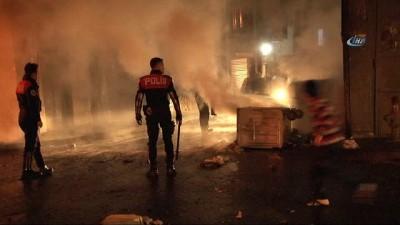 Beyoğlu'nda çöp konteynerlerini yola devirip ateşe verdiler