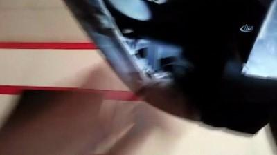 Aracın motoruna sıkışan kediyi tamirci ustası kurtardı