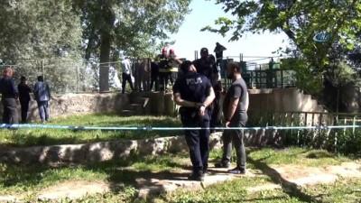 Sulama kanalında kolu kesik kadın cesedi bulundu