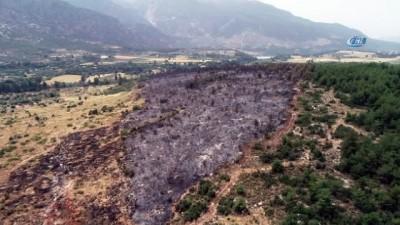 Seydikemer'de yanan alan havadan görüntülendi
