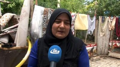 Evlerini su basan aileler yaralarını sarıyor