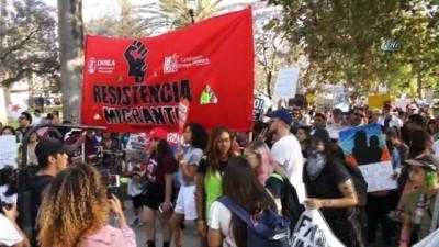 - Los Angeles'ta Binlerce Kişi Göçmen Yasasını Protesto Etti