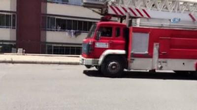 yangin yeri -  Apartman yangınında mahsur kalan 20 kişi itfaiye tarafından kurtarıldı