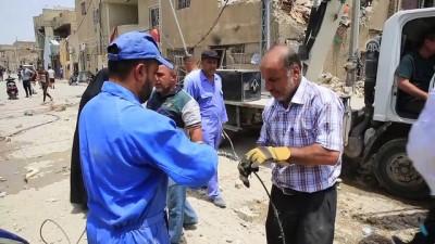 Irak'taki bombalı saldırı - Enkaz kaldırma çalışmaları - BAĞDAT