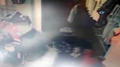 Yangının tüpü ile camı kıran elbise hırsızları kamerada