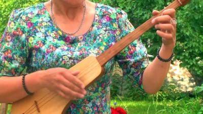 Kaybolan Kırgız geleneksel müzik aletleri hayata dönüyor - BİŞKEK