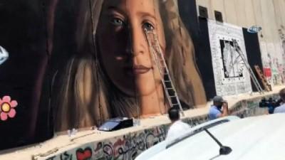 """- Filistinli Sanatçılar, Ayrım Duvarı'na """"Cesur Kız"""" Tamimi'nin Resmini Çizdi"""