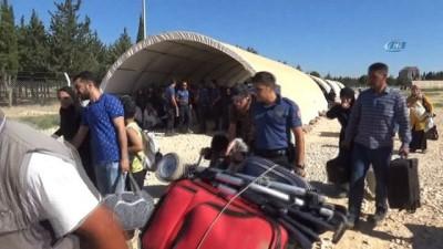 Aşırı sıcaklara aldırış etmediler...13 bin Suriyeli bayram için ülkelerine gitti