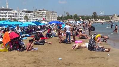 kopek - Sıcak hava sahilleri doldurdu - MERSİN