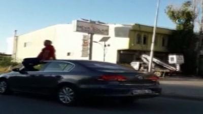 - Arabayı tavanına oturup kullanan sürücüye ceza