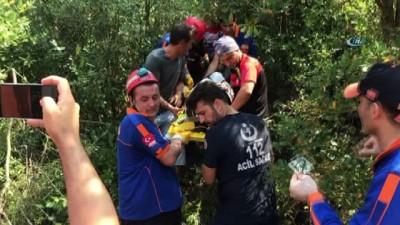 Yamaç paraşütü yapan genç kız ağaçlık alana çakıldı: 1 yaralı
