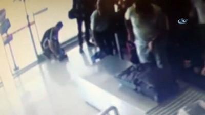 Uçağa binmek isterken üzerindeki uyuşturucu ile yakalandı... Şüpheli şahıs güvenlik kamerasında