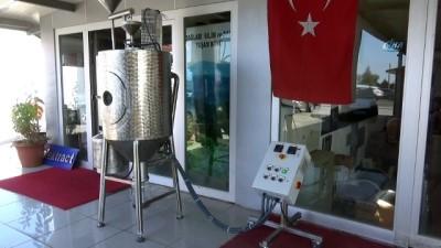 100 bin dolara ithal edilen makineyi 60 bin liraya Türkiye'de üretti