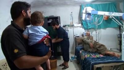 - Suriye'deki mağara hastanede gaz maskeli tedbir - Suriye'deki mağara hastanelerde çalışanlar kimyasal saldırılar için gaz maskesini hazır bulunduruyor