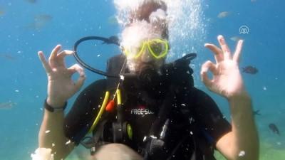 Bedensel engelli AKUT lideri tekerlekli sandalyeyle su altında - MUĞLA
