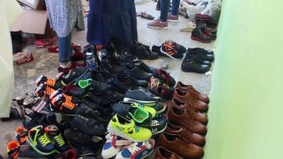 'Simitçi Erkan' Suriyeli yetimlerin ayaklarını ısıttı - HATAY