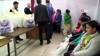 konferans -  Siverek'te ihtiyaç sahibi öğrencilere giysi yardımı