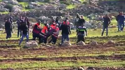 İsrail askerleri Batı Şeria'da 4 Filistinliyi yaraladı - RAMALLAH