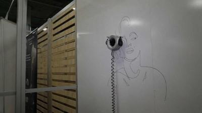 Google'ın duvara resim çizebilen robotu ve eşzamanlı tercüme yapabilen yazılımı ilgi gördü