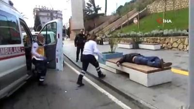 Manavgat'ta bank üzerinde sızan alkollü şahıs polis ve sağlık ekiplerini alarma geçirdi
