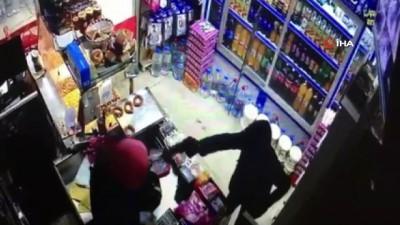 Market sahibini gasp eden zanlının PKK terör örgütü adına silah eğitimi aldığı tespit edildi...Soygun anı kamerada