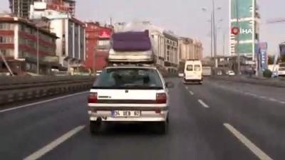 E-5'te tehlikeli yolculuk...Koltuğu ve yatağı arabanın üstünde taşıdı