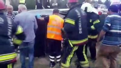 Otomobilin tavanını kesip 6 kişiyi kurtardılar