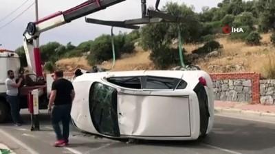 Hamile kadının kullandığı otomobil istinat duvarına çarptıktan sonra takla attı