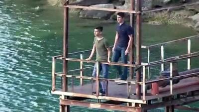 yuzme - Baraj gölüne giren genç kayboldu - ADANA