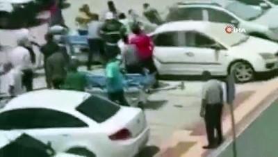agir yarali -  Alev alan otomobildeki engellinin kurtarılma anı kamerada