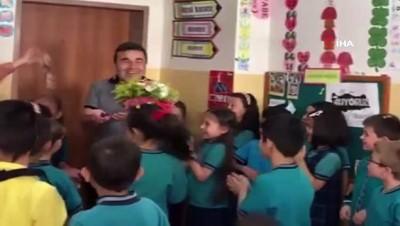 Tedavisinin ardından okula dönen öğretmenlerini konfeti ile karşıladılar