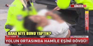 Yolun ortasında hamile eşini dövdü