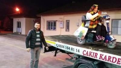 Bolu'da, akülü aracı bozulan engelliyi çekiciyle evine taşıdı